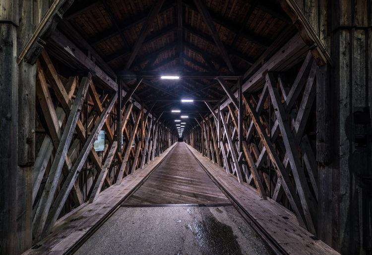Illuminated footbridge in tunnel