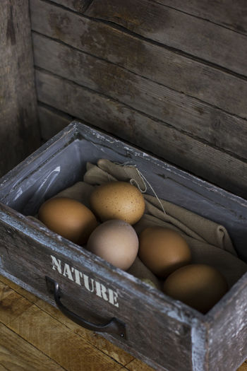 High angle view of eggs in crate