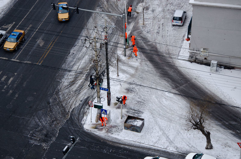 High angle view of vehicles on snow