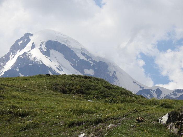 mountain peak kazpiji Georgia Mountain Cloud - Sky Mountain Range No People Grass Day Nature