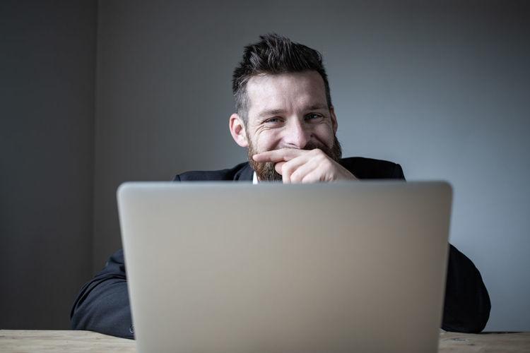 Portrait of a man using smart phone