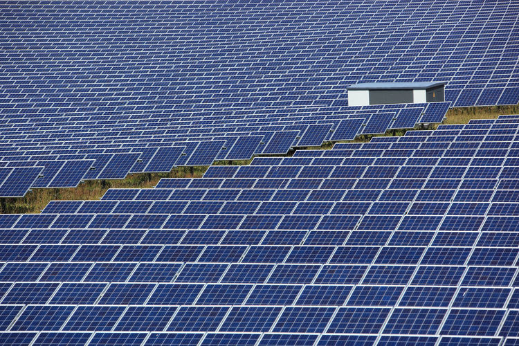 photovoltaic power station, a solar park Alternative Energy Blue Business Economy Electricity  Environment Environmental Conservation Environmental Issues Finance Fuel And Power Generation Industry Nature Pattern Power Supply Renewable Energy Sky Solar Energy Solar Panel Solar Power Station Sun Technology