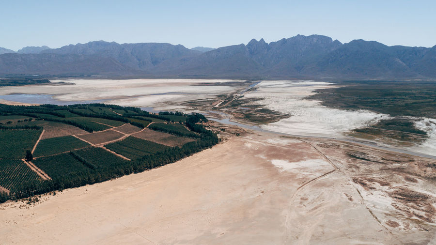 The Theewaterskloof Dam in Cape Town, South Africa. This is the result of the water crisis that is happening in Cape Town at the moment! Cape Town Drone  South Africa Agriculture Arid Climate Beauty In Nature Clear Sky Day Drone Photography Field Landscape Mountain Mountain Range Nature No People Outdoors Patchwork Landscape Rural Scene Salt - Mineral Scenics Sky Tranquil Scene Tranquility