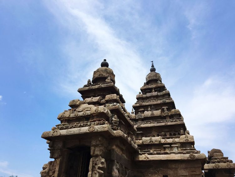 Architecture Spirituality Place Of Worship Low Angle View Religion Built Structure Sky Cloud - Sky History Building Exterior Ancient Civilization Travel Destinations Day Ancient Old Ruin No People Statue Outdoors EyeEm Selects Incredibleindia The Great Outdoors - 2017 EyeEm Awards Travel Photography Mahabalipuram, India Fun Shoretemple Investing In Quality Of Life