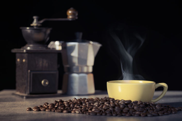 Cup of coffee with coffee bean on black background Coffee Cup Bean Hot Drink Steam