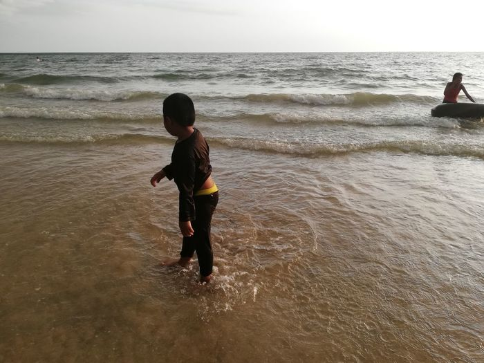 Children enjoy on summer trip 2019,หาดเจ้าหลาว Achi2019 Sea Water Beach Horizon Over Water Land Horizon Sky Real People Child Leisure Activity Lifestyles Childhood Beauty In Nature Boys Males  Nature One Person Motion Scenics - Nature Outdoors