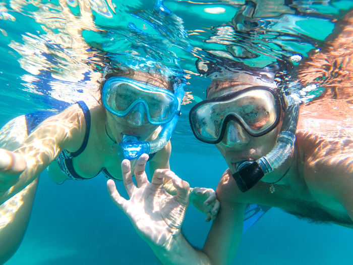 Underwater selfie of a young attractive love couple swimming in turquoise sea water under the surface Underwater Sea Sport Water Aquatic Sport Swimming Snorkeling Scuba Diving UnderSea Swimwear Scuba Mask Adventure Holiday Vacations Eyewear Leisure Activity Underwater Diving Nature Couple Couple - Relationship Honeymoon Lovers Ocean Tropical Paradise Holiday