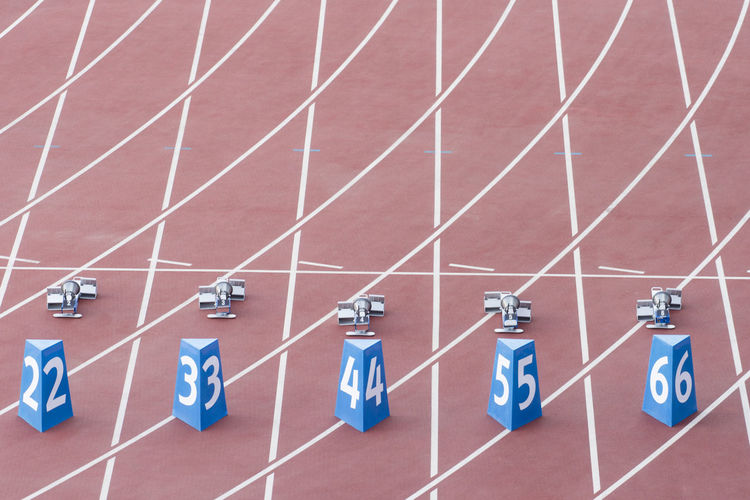 High angle view of numbers on running track at stadium