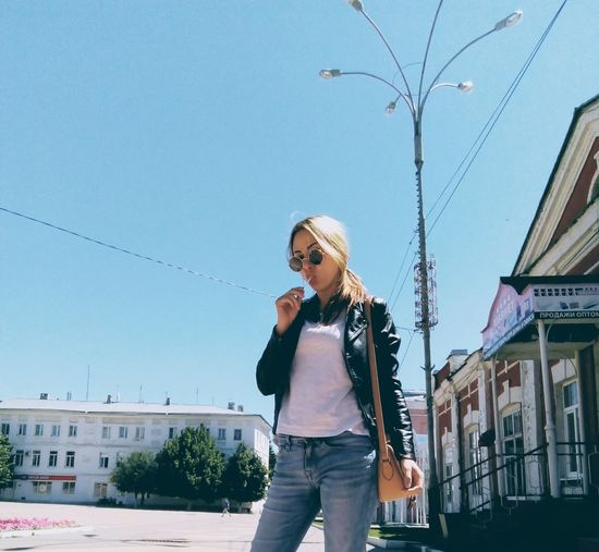 Girl Pose Posing Summertime Pretty Jeans Street Fashion Glasses Sunlight Summer Leather Jacket City Young Women Clear Sky Blond Hair Portrait Standing Beauty City Street Building Denim
