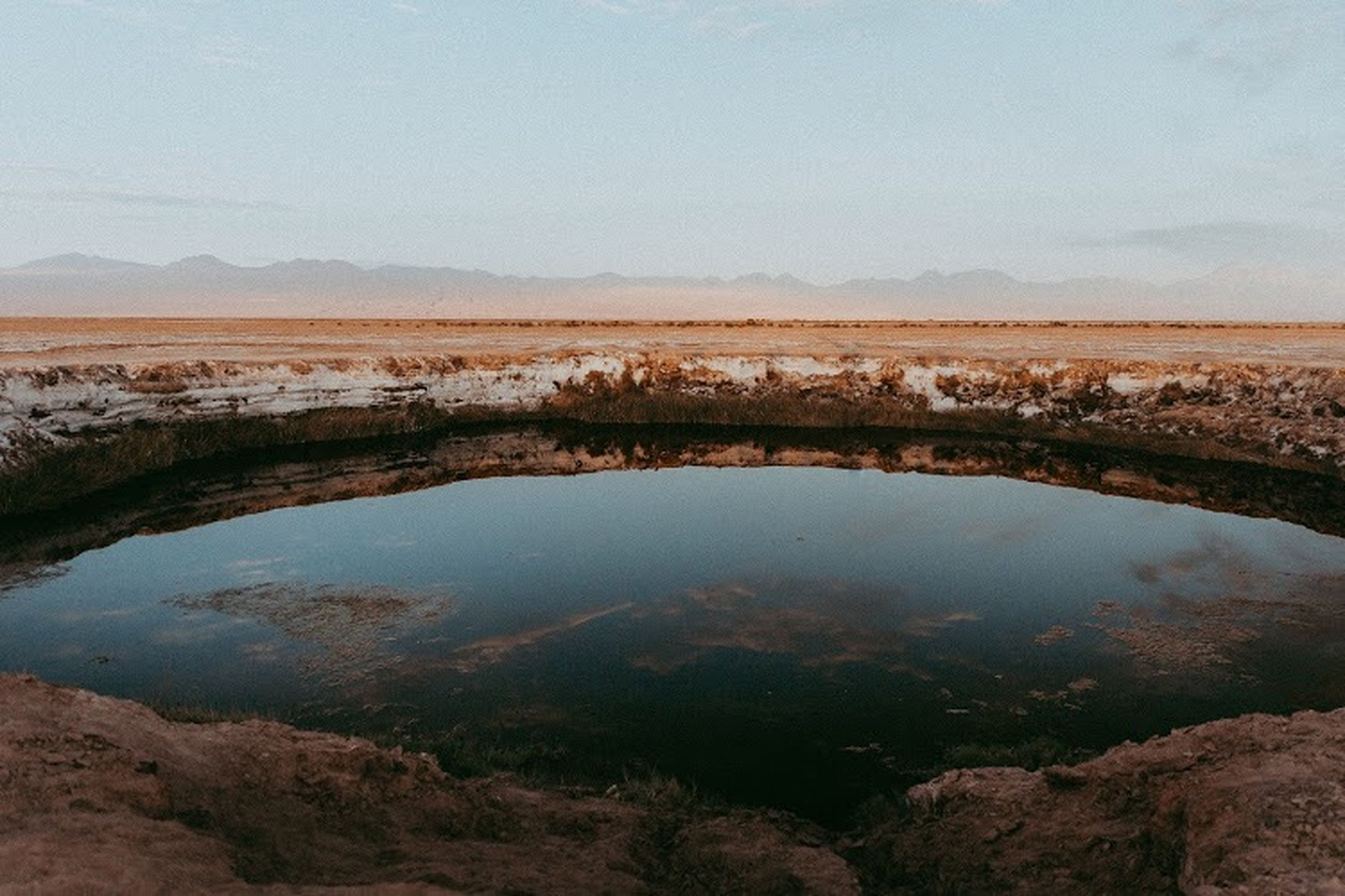 scenics - nature, tranquil scene, tranquility, beauty in nature, water, no people, sky, landscape, non-urban scene, environment, reflection, nature, mountain, day, lake, remote, plant, high angle view, land, outdoors