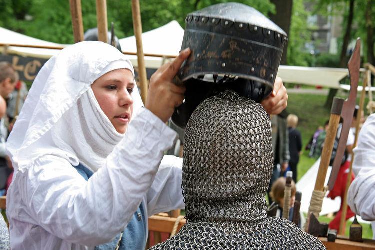 St.George's Day,fair,22,lady dressing the child,Zagreb,Croatia,EU, 2016. Armour Child Croatia Day Dressing Eu Fair Helmet Lady Outdoors St.George's Day Young Warrior Zagreb