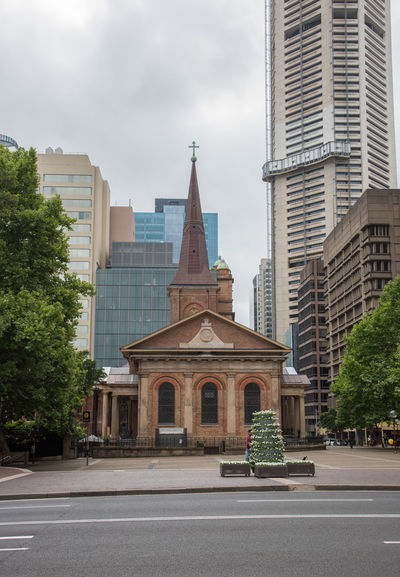Sydney,NSW,Australia-November 19,2016: St. James Anglican Church in the Queen's Square area of Sydney, Australia Australia Church City Cityscape Cross St. James Anglican Architecture Building Exterior Built Structure City Early Colonial Georgian Historic Modern Outdoors Parish Place Of Worship Queen's Square Religion Skyscraper Spire  Spirituality Steeple Sydney