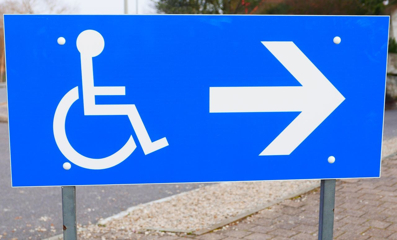 Close-Up Of Disabled Parking Sign