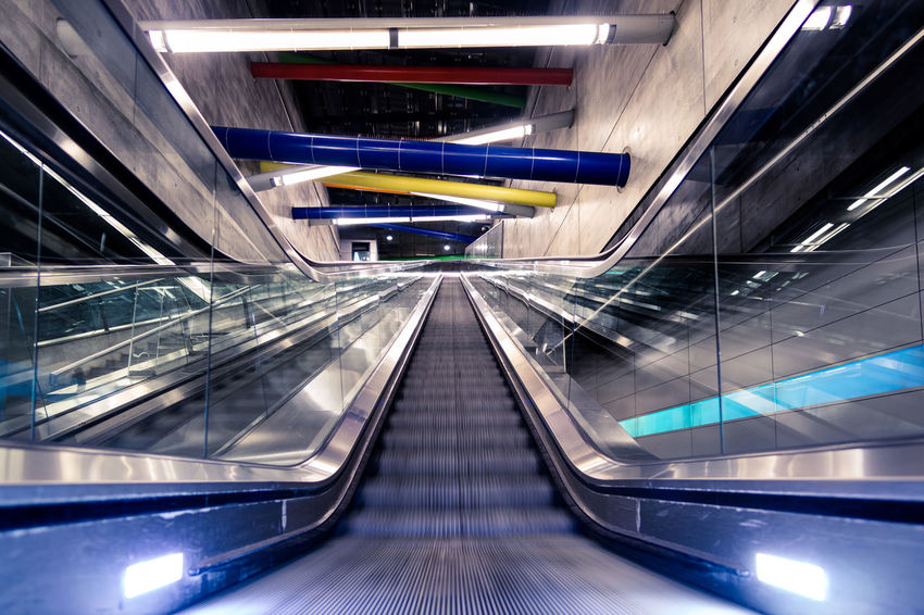 Leipzig Metro Station The Architect - 2018 EyeEm Awards Architecture Connection Convenience Diminishing Perspective Direction Escalator Futuristic Illuminated Indoors  Modern Motion Moving Walkway  No People on the move Railing Staircase Steps And Staircases Subway Station Technology The Way Forward Transportation