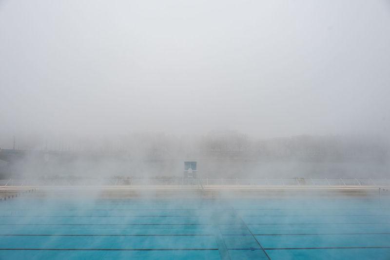 Outside swimming pool in winter Fog Landscape Lyon Mist No People Rhône Steam Swimming Pool Water Winter EyeEmNewHere France Piscine Vapeur The City Light