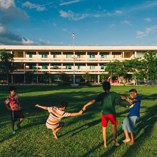 Architecture Boys Building Exterior Childhood Day Friendship Full Length Grass Leisure Activity Nature Outdoors Patriotism People Real People Sky Sport Togetherness Tree