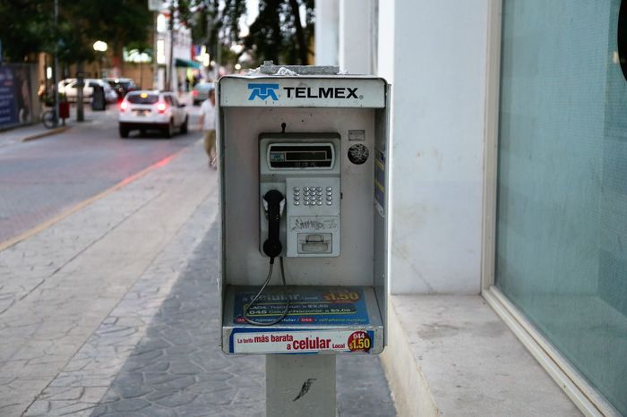 Pubic Telephone in Mexico Public Telephone Telephone Box Telephone Pole Close-up Communication Day No People Outdoors Pay Phone Telephone Telephone Booth Telephone Line Telephone Photography Telephones Around The World Telmex Text