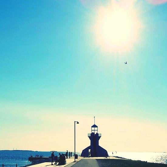 The sun, the bird and the lighthouse.. familytime by the beach during summer.. Beach Photography Beach Walk Summer By The Beach Lighthouse Shot By The Seaside By The Beach Summertime Family Time By The Beach During Summer Lighthouse Tower Pivotal Ideas Nallikari Beacon Shot Colours Of Life Lighthouse Dayshot Sunny Day By The Lighthouse Landscape_photography