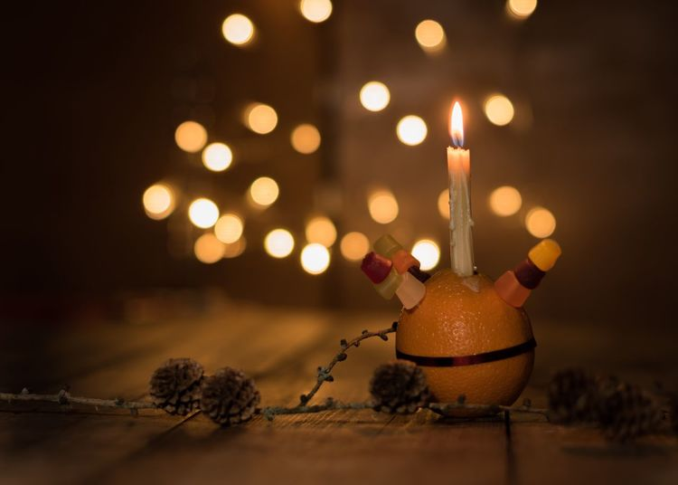 Orange Christingle EyeEm Selects Celebration Illuminated Holiday Candle Decoration Christmas Lights Christmas Christmas Decoration Event Night Indoors  No People Burning Celebration Event Christmas Ornament Holiday - Event Advent