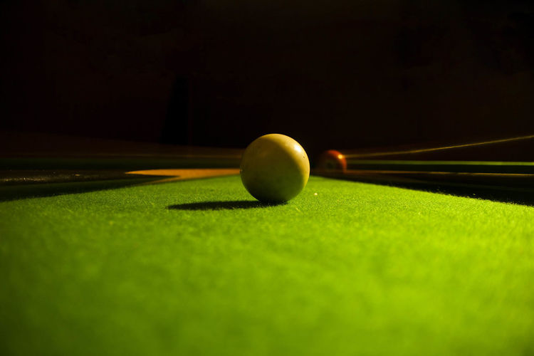 Close-Up Of Cue Balls On Table