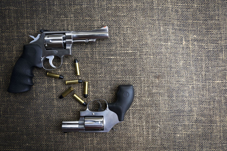 Directly Above Shot Of Pistols And Bullets On Table