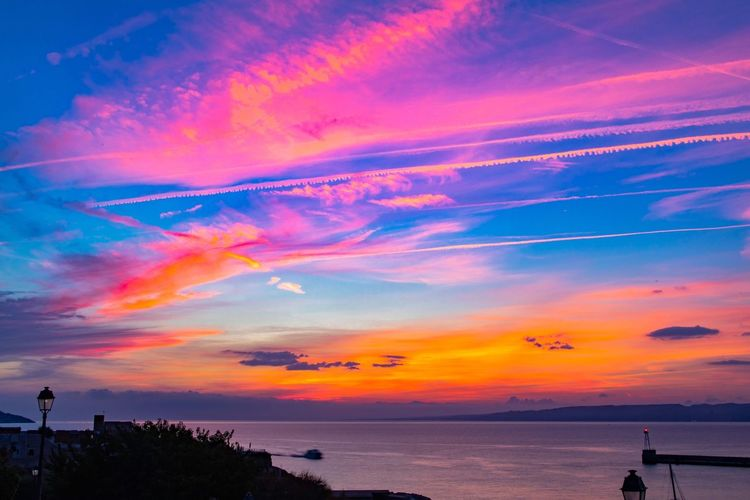Sunset above Mediterranean sea Sunset Sky Water Beauty In Nature Sea Cloud - Sky Scenics - Nature Orange Color Tranquil Scene Horizon Multi Colored Tranquility Horizon Over Water Idyllic