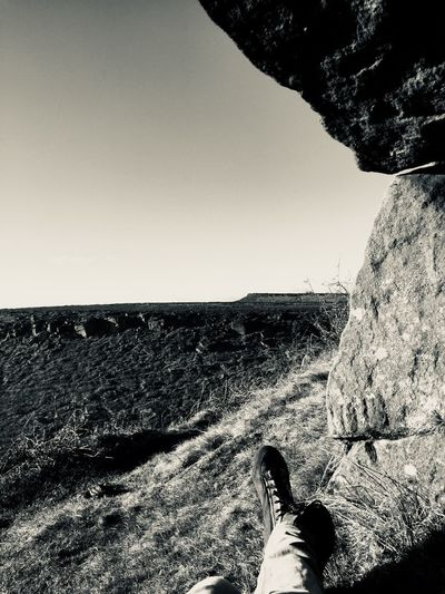 Peak District chilling Gritstone Peak Peak District  Monochrome Black And White Landscape Nature Outdoors Bouldering Climbing Low Section Human Leg One Person Personal Perspective Human Body Part Shoe Day Clear Sky Lifestyles Sky Scenics