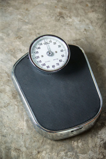 High angle view of weight scale on floor