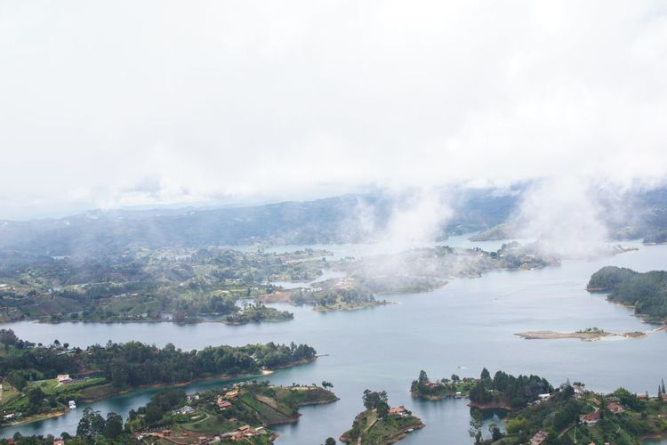 Guatape Colombia 7 Swinginginaplumtree Bluewater Whiteclouds Farview Guatapé Reservoir Colombia Boat At Far Birdview Beauty In Nature Scenics Nature Water No People High Angle View Day Outdoors Tree Sky Tranquility Mountain