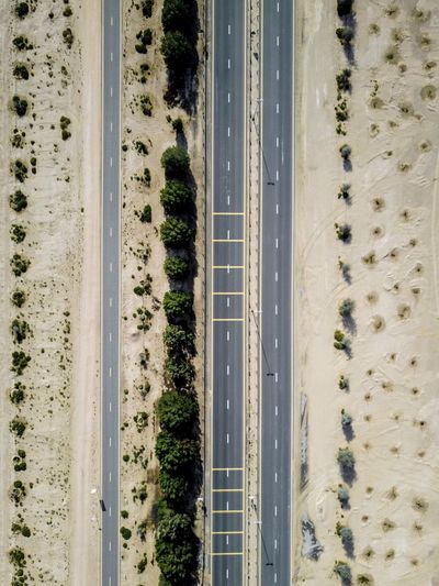 Road from above in Dubai No People Water Road Day Aerial View Nature Motion Outdoors Airport Runway Tree