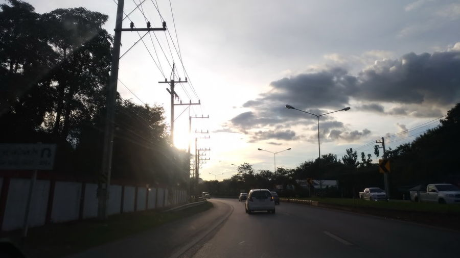 Architecture Car City Cloud - Sky Electricity  Electricity Pylon Land Vehicle Mode Of Transportation Motor Vehicle Nature No People Outdoors Plant Power Supply Road Sky Street Sunset Technology The Way Forward Transportation Tree