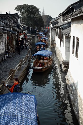 Nautical Vessel Building Exterior Built Structure Transportation Canal Water Architecture Day Mode Of Transport Outdoors Travel Destinations Moored Men Real People Gondola - Traditional Boat Adult Oar Large Group Of People Rowing People