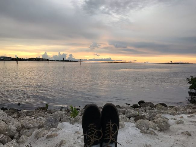 Antz it's your shoes ? Water Sky Sea Cloud - Sky Beach Beauty In Nature Sunset Land Nature Shoe Tranquil Scene One Person Outdoors