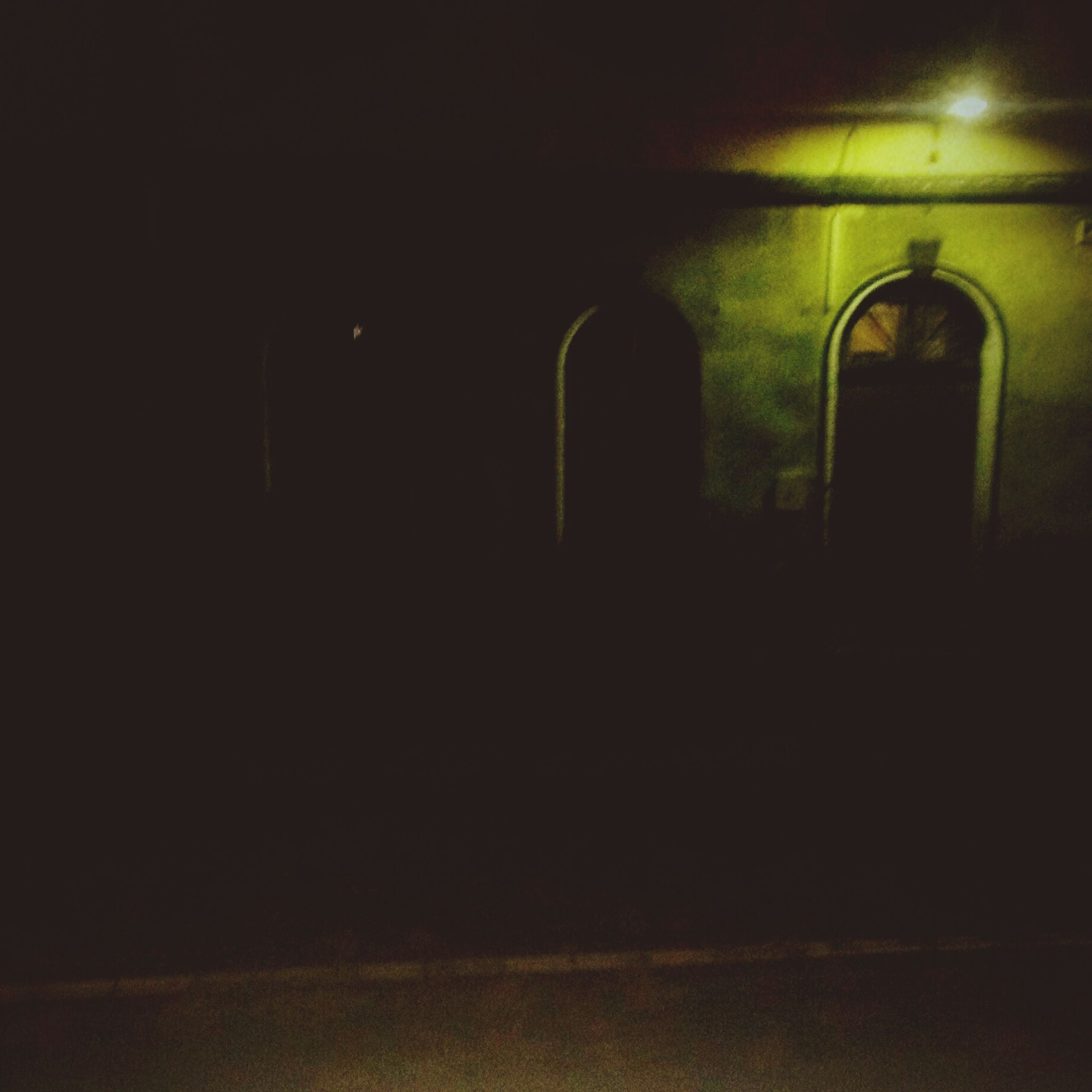 indoors, dark, built structure, architecture, copy space, window, night, illuminated, wall - building feature, silhouette, wall, arch, no people, reflection, house, lighting equipment, empty, door, darkroom, light - natural phenomenon