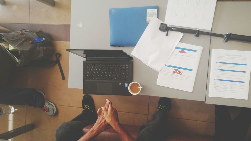 Working Brainstorming Coffee Time Laptop Gopro Paperwork