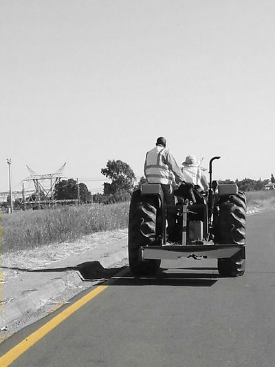 Outdoors Tractor Transportation Farm Equipment Adults Only Tractors Black And White Road Travel Two People Tractors Among Us Only Men Power Line