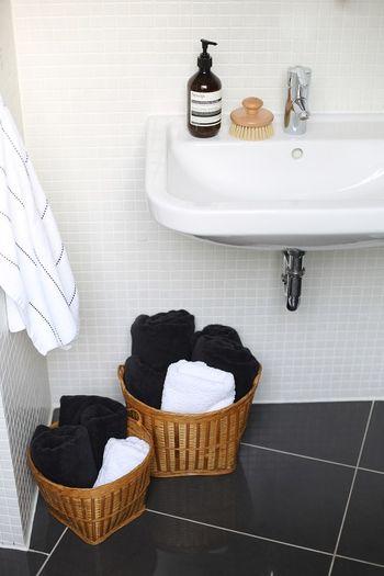 H & M  Stripes Aesop Basket Bathroom Bathroom Sink Blackandwhite Domestic Bathroom Grey Grey Tiles Health Spa Indoors  Interior Design Interior Styling Organic Soap Towel Wooden