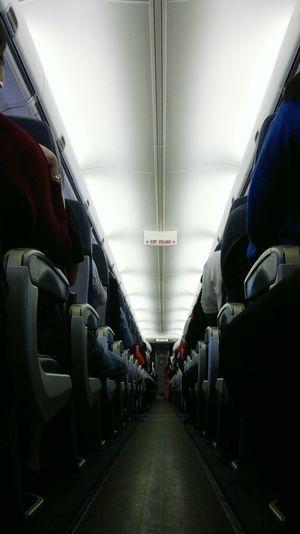 Photo Randomshot Randomphoto Dimly Lit Hallway Plane Indoors  Vehicle Seat Transportation Symmetry People Adult