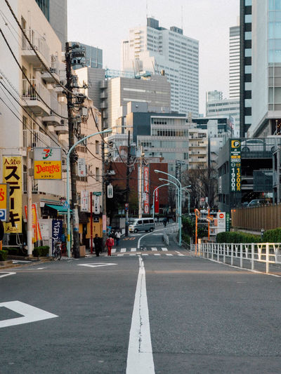 On my way Architecture Building Building Exterior Built Structure City City Life City Street Day Diminishing Perspective Empty Information Sign Japan Modern Office Building Outdoors Road Road Marking Road Sign Sky Street Streetphotography The Way Forward Tokyo Vanishing Point ULT