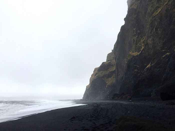 Iceland Volcanic  Idyllic Volcanic Landscape Black Sand Beach Water Sea Sky Beach Beauty In Nature Land Rock Nature Scenics - Nature Rock Formation Motion Rock - Object Wave Day Solid No People Horizon Over Water Clear Sky Non-urban Scene Outdoors
