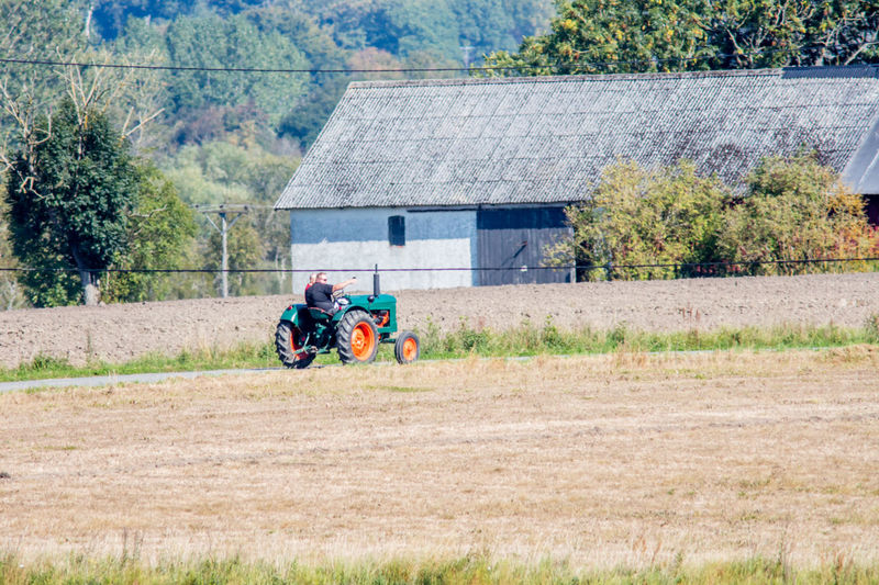 Agriculture Boys Building Exterior Countryside Cultivated Land Day Farm Field House Outdoors Rural Scene Sweden Togetherness Tractor Transportation