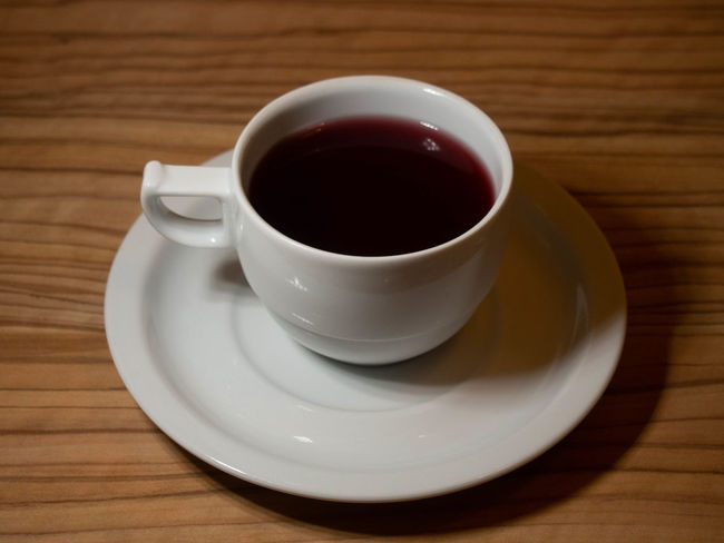 Food And Drink Crockery Drink Saucer Refreshment Mug Table Cup Indoors  Coffee Cup Coffee Still Life Coffee - Drink Freshness Wood - Material Close-up High Angle View No People Food White Color Tea Cup Black Tea Snack Non-alcoholic Beverage