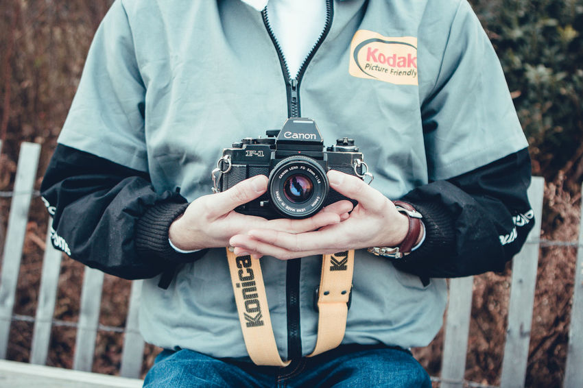 Adult Camera - Photographic Equipment Casual Clothing Close-up Day Focus On Foreground Front View Men Midsection One Person Outdoors People Photographer Photographing Photography Themes SLR Camera Technology