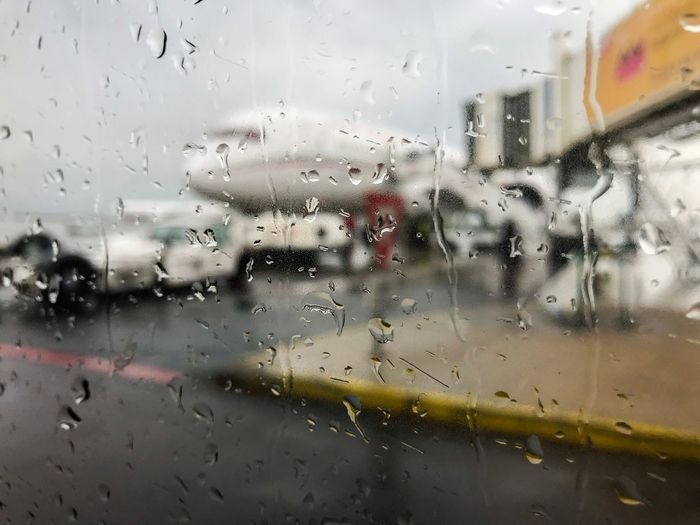Boarding Time instagram : medtmart Airport Glass - Material Window Transparent Drop Wet Rain Airplane Indoors  Weather No People Close-up Backgrounds Air Vehicle Mode Of Transport Full Frame Travel Transportation Airport RainDrop Water