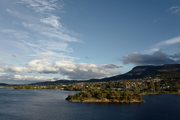 Shot in Tasmania, Australia. Architecture Beauty In Nature Building Exterior Built Structure Cityscape Cloud - Sky Day Lake Landscape Mountain Mountain Range Nature No People Outdoors Scenics Sky Tranquil Scene Tranquility Travel Destinations Water Waterfront
