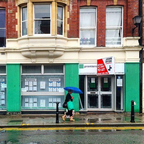Gloucester Saint Aldate Street Street Streetphotography Woman Walking Raining Umbrella Architecture Building