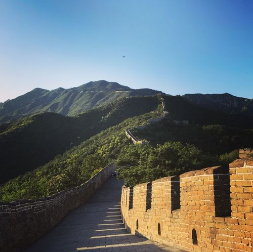 Chinese Wall, Mutianyu section China Mutianyu Great Wall Architecture Built Structure Building Exterior Mountain Nature Clear Sky Outdoors History Beauty In Nature No People Tranquility Travel Destinations Mountain Range Tree Sky