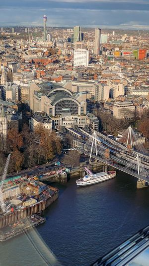 High angle view of bridge over river and buildings in city