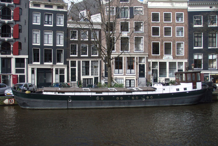 Amsterdam Architecture Bar Boat Building Building Exterior Canal City Cityscape Europe Façade Landscape Netherlands Outdoors Residential Building Residential Structure River Travel Tree Water Window Windows