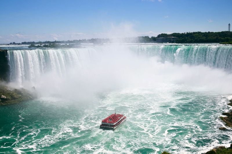 This shows why the vessel is called the 'Maid of the Mist,' as the falls throw up so much water droplets into the air. A sight to behold! Niagara Falls Canada Beauty In Nature Flowing Water Maid Of The Mist Nature Nautical Vessel No People Outdoors Passenger Craft Power Power In Nature Scenics - Nature Travel Destinations Water Waterfall